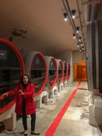 Our lovely tour guide at Maison Mumm, wearing red to match their signature color